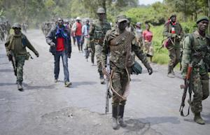 Congolese army soldiers march through Rugare after …