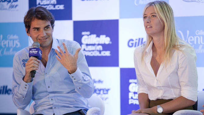 Tennis players, Roger Federer, of Switzerland, and Maria Sharapova of Russia hold a press conference to promote the Gillette Federer Tour, in Sao Paulo, Brazil, Thursday, Dec. 6, 2012. Federer will take on Brazilian Thomaz Bellucci in an exhibition match Thursday evening, Sharapova and Danish tennis star Caroline Wozniacki are scheduled for a Friday match. (AP Photo/Andre Penner)