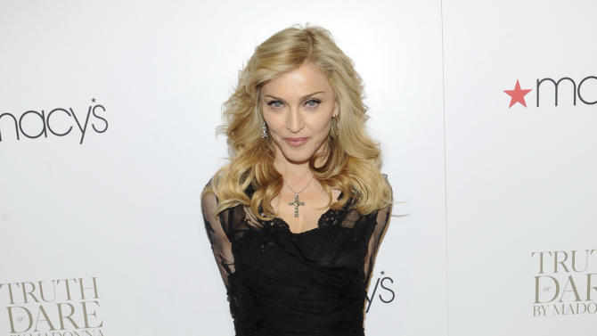 FILE - In this April 12, 2012, file photo, Madonna arrives at Macy's Herald Square in New York. Israelis are gearing up to get down at Madonna's show as the pop diva landed in the holy land Friday, May 25, 2012 ahead of her world tour which kicks off here next week. (AP Photo/Evan Agostini, File)