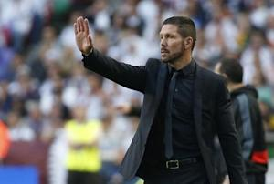 Atletico Madrid's coach Simeone delivers instructions during their Champions League final soccer match against Real Madrid at the Luz Stadium in Lisbon