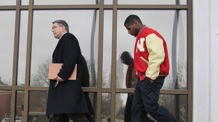 New England Patriots cornerback Alfonzo Dennard follows his attorney Terry Dougherty as they leave the Lancaster County courthouse in Lincoln, Neb., Thursday, April 11, 2013 after being sentenced to two years probation, 100 hours of community service and 30 days in jail starting March 1, 2014. Dennard was found guilty of assaulting a police officer and resisting arrest in an incident in Lincoln, Neb. last year. (AP Photo/Nati Harnik)
