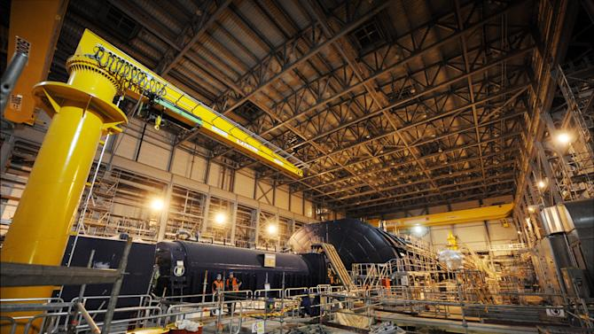 In this March 23, 2011 photo, the turbine hall of the nuclear power plant Olkiluoto 3 'OL3' is pictured under construction in Eurajoki, south-western Finland. Halfway around the globe from Japan's atomic emergency, engineers building a cutting-edge nuclear reactor along Finland's icy shores insist the same crisis could never happened there. And that's not only because Finland is seismically stable. The 1,600-megawatt European Pressurized Reactor projected to come online in 2013 in Olkiluoto, 195 miles (315 kilometers) northwest of Helsinki, is the first of its kind expected to begin operating after the Japanese disaster. (AP Photo/Lehtikuva, Antti Aimo-Koivisto) FINLAND OUT NO SALES