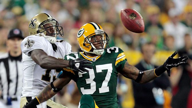 Green Bay Packers' Sam Shields (37) breaks up a pass intended for New Orleans Saints' Devery Henderson during the first half of an NFL football game Thursday, Sept. 8, 2011, in Green Bay, Wis. (AP Photo/Mike Roemer)