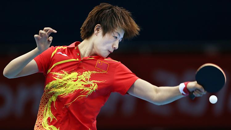 Ning Ding of China competes against Jie Li of the Netherlands during women's team table tennis competition at the 2012 Summer Olympics, Saturday, Aug. 4, 2012, in London. (AP Photo/Sergei Grits)
