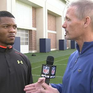 NFL Media's Mike Mayock chats with Auburn's defensive back Nick Marshall at the university's pro day