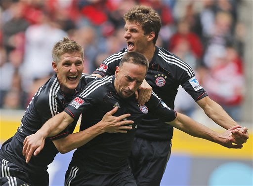 Bayern's Bastian Schweinsteiger, from left, Franck Ribery of France and Thomas Mueller celebrate after scoring during the German first division Bundesliga soccer match between VfL Borussia Moenchengla
