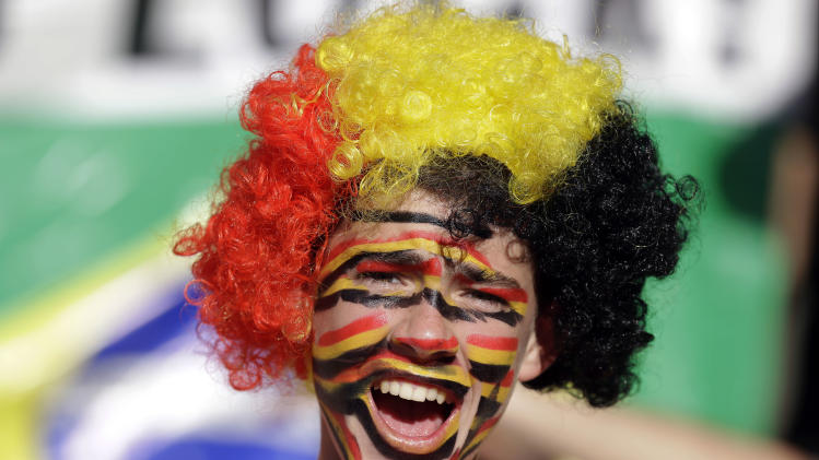A Germany supporter smiles prior to the World Cup final soccer match between Germany and Argentina at the Maracana Stadium in Rio de Janeiro, Brazil, Sunday, July 13, 2014. (AP Photo/Victor R. Caivano)