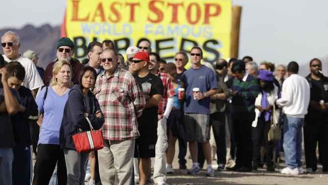 A crowd, consisting of residents from California and Nevada, lines up outside the Arizona Last Stop convenience store and souvenir shop to buy Powerball tickets, Tuesday, Nov. 27, 2012, in White Hills, Ariz. There has been no Powerball winner since Oct. 6, and the jackpot already has reached a record level for the game of over $500 million. (AP Photo/Julie Jacobson)