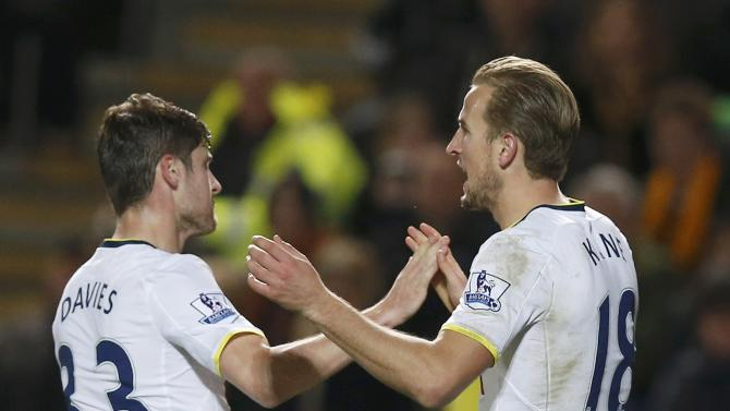 Tottenham Hotspur's Harry Kane celebrates scoring a goal with team-mate Ben Davies during their English Premier League soccer match against Hull City at the KC Stadium in Hull
