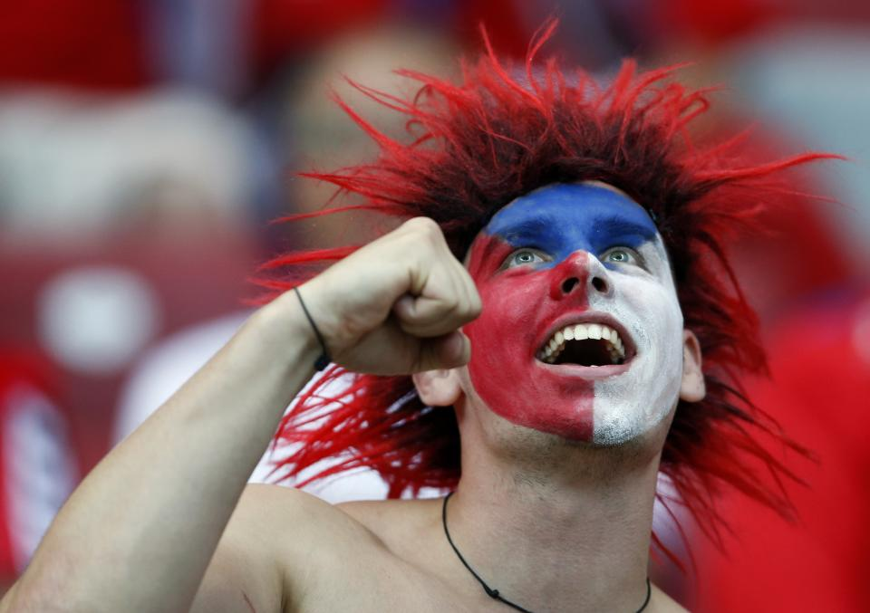 A Czech fan cheers before the Euro 2012 soccer championship quarterfinal match between Czech Republic and Portugal in Warsaw, Poland, Thursday, June 21, 2012. (AP Photo/Petr David Josek)