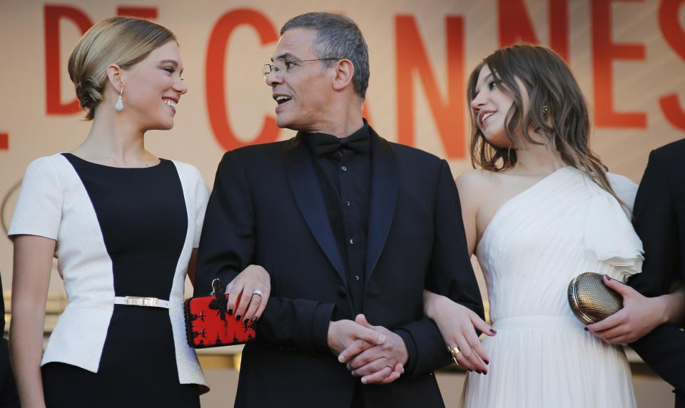 From left,actress  Lea Seydoux, director Abdellatif Kechiche, centre, and actress Adele Exarchopoulos pose for photographers as they arrive for the awards ceremony of the 66th international film festival, in Cannes, southern France, Sunday, May 26, 2013. (AP Photo/Lionel Cironneau)