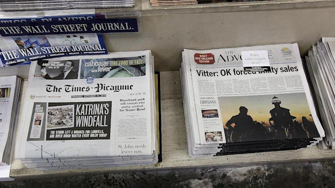 Free introductory copies of the Baton Rouge Advocate's new New Orleans edition, right, are seen next to copies of the New Orleans Times-Picayune at Lakeside News in the New Orleans suburb of Metairie, La., Thursday, Sept. 27, 2012.  As The Times-Picayune in New Orleans scales back its print edition to three days a week, the Baton Rouge newspaper is starting its own daily edition to try to fill the void. The move by The Advocate sets up an old-fashioned newspaper competition, even as more and more people get their news online and from cellphones.(AP Photo/Gerald Herbert)