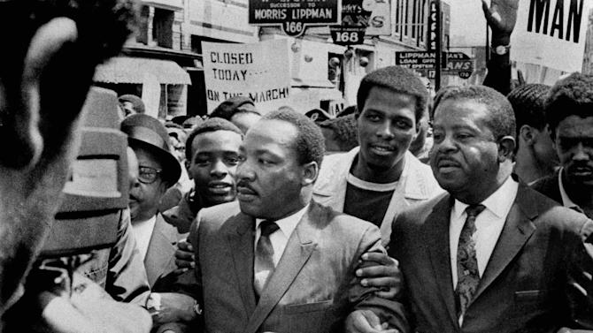 FILE -In this March 28, 1968 file photo, Dr. Martin Luther King Jr. and Rev. Ralph Abernathy, right, lead a march on behalf of striking Memphis, Tenn., sanitation workers. Forty-five years after Martin Luther King Jr. was killed supporting a historic sanitation workers strike in Memphis, the city's garbage and trash collectors are fighting to hold on to jobs that some city leaders want to hand over to a private company. (AP Photo/The Commercial Appeal, Sam Melhorn, File)