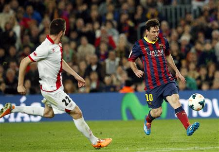 Barcelona's Messi kicks a ball before scoring during their Spanish first division soccer match in Barcelona