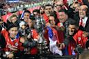Chile's players celebrate with the trophy after winning the Copa America championship final match against Argentina, in Santiago, on July 4, 2015