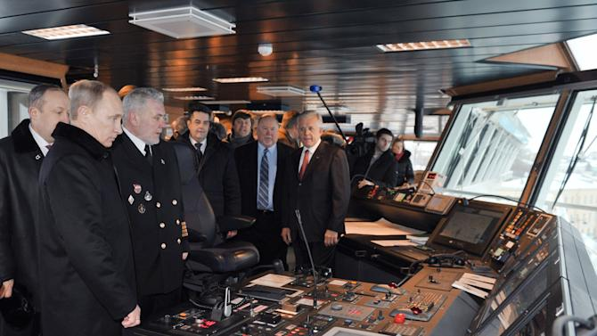 Russian President Vladimir Putin, foreground left, visits a bridge of a multi-purpose ice breaker at a shipyard in  St .Petersburg Russia on Thursday, Jan. 10, 2013 after the naming of the ship ceremony.(AP Photo/RIA Novosti, Alexei Nikolsky, Presidential Press Service)