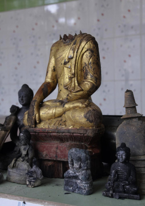 Damaged statues at a Buddhist temple that was torched in Ramu in the coastal district of Cox's Bazar, Bangladesh, Sunday, Sept. 30, 2012. Thousands of Bangladeshi Muslims angry over an alleged derogat