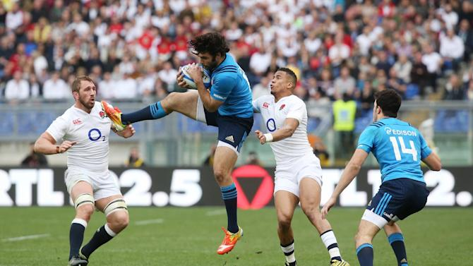 England's Chris Robshaw and Anthony Watson in action with Italy's Michele Campagnaro