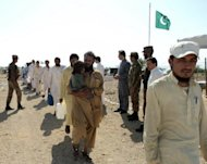 Tribesmen walk towards buses to return to their homes in South Waziristan last October following a period of calm. Thousands of people have fled one of Pakistan's troubled northwestern tribal districts in recent days, fearing a military offensive against Islamist militants, locals and officials said