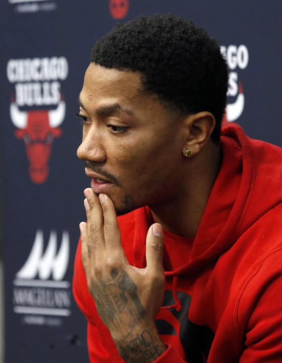 Chicago Bulls guard Derrick Rose responds to a question about his injured knee during an NBA basketball news conference at the United Center Thursday, Dec. 5, 2013, in Chicago