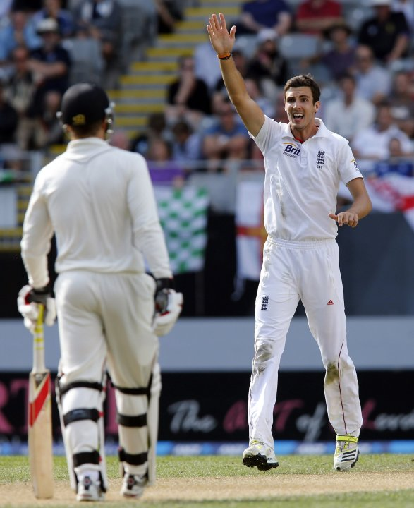 Finn of England appeals successfully for the wicket of New Zealand's Watling watched by New Zealand's Martin during day two of their final cricket test match at Eden Park in Auckland