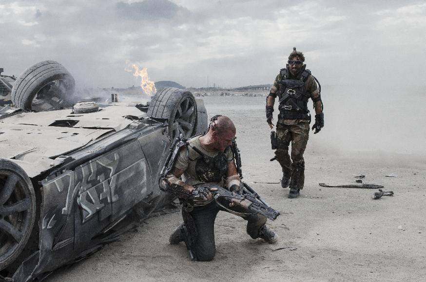 "This film publicity image released by TriStar, Columbia Pictures-Sony shows Matt Damon, left, and Sharlto Copley in a scene from ""Elysium."" (AP Photo/TriStar, Columbia Pictures - Sony, Stephanie Blomkamp)"