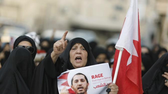 A woman shouts anti-government slogans during a demonstration for Salman in the village of Bilad Al Qadeem