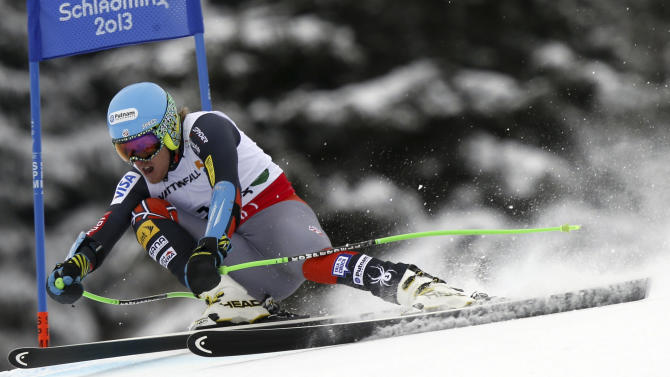 United States' Ted Ligety speeds down the course during the men's super-G, at the Alpine skiing world championships in Schladming, Austria, Wednesday, Feb.6, 2013. (AP Photo/Alessandro Trovati)