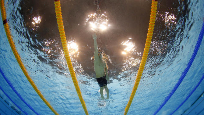 United States' Michael Phelps competes in the men's 4x200-meter freestyle relay swimming final at the Aquatics Centre in the Olympic Park during the 2012 Summer Olympics in London, Tuesday, July 31, 2012. (AP Photo/Mark J. Terrill)