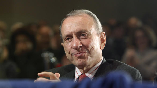 FILE - In this Sept. 30, 2009, file photo, Sen. Arlen Specter, D-Pa., reacts to being acknowledged by President Barack Obama, who spoke National Institutes of Health in Bethesda, Md. Specter, Pennsylvania's longest-serving U.S. senator, will be remembered at a public funeral service attended by Vice President Joe Biden, his longtime senate colleague. President Barack Obama has ordered flags to be flown at half-staff at the White House and other public buildings Tuesday in honor of the former senator. (AP Photo/Gerald Herbert, File)