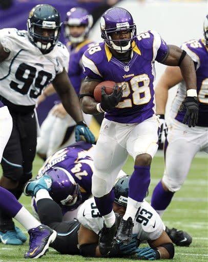 Peterson steps back in, Vikings beat Jaguars 26-23