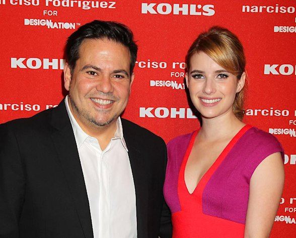 "FILE - This Oct. 22, 2012 file photo released by Starpix shows fashion designer Narciso Roriguez, left, with actress Emma Roberts at the Narciso Rodriguez for DesigNation launch in partnership with Kohl's department store in New York. Rodriguez has joined the likes of Jason Wu and Missoni by launching a limited-edition collection with a more affordable national retailer. Roberts said she appreciates the accessibility of the collection for Kohl's. ""I love when these big designers are collaborating with places to make their stuff more accessible to everybody and also just making kind of more everyday pieces because so many of these designers I love, but they do these gowns that you can't exactly wear to the supermarket."" (AP Photo/Starpix, Dave Allocca)"