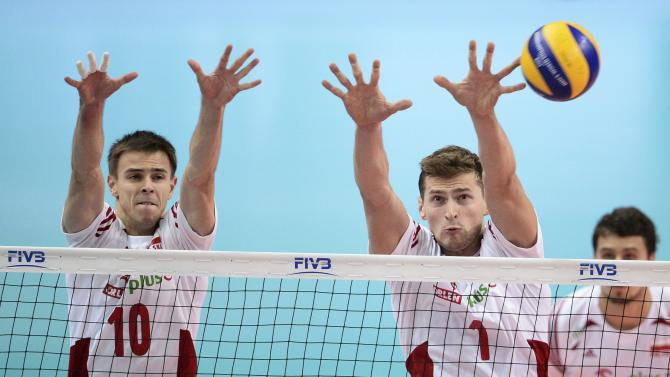 Poland's Wlazly and Nowakowski block shot from Brazil in Volleyball Men's World Championship final in Katowice