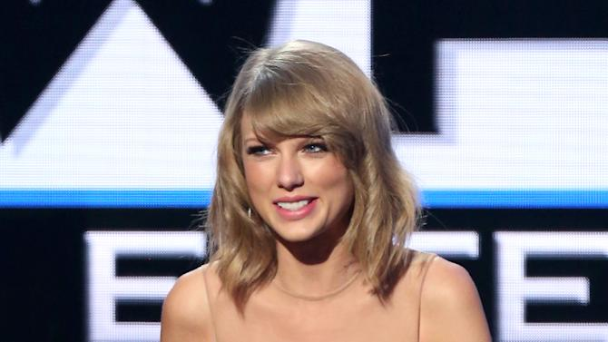 Taylor Swift accepts the Dick Clark award for excellence at the 42nd annual American Music Awards at Nokia Theatre L.A. Live on Sunday, Nov. 23, 2014, in Los Angeles. (Photo by Matt Sayles/Invision/AP)