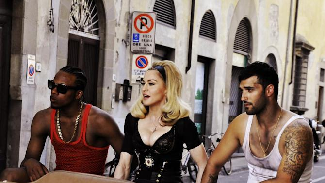 "This undated image released by Guy Oseary shows pop star Madonna, center, during the filming of her music video for her new single, ""Turn Up The Radio,"" in Florence, Italy. The video will premiere on Vevo on Monday, July 16, 2012.  (AP Photo/Guy Oseary)"