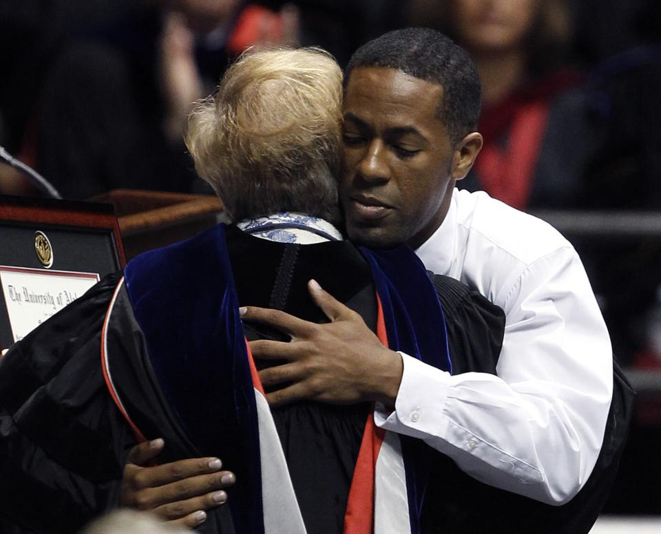 Micah Smith hugs Universtiy Provost Dr. Judy Bonner as he accepts the degree from the University of Alabama on behalf of his brother Marcus Smith on Saturday, Aug. 6, 2011 in Tuscaloosa, Ala. Marcus lost his life when a tornado ripped through Tuscaloosa on April 27, 2011. (AP Photo/Butch Dill)