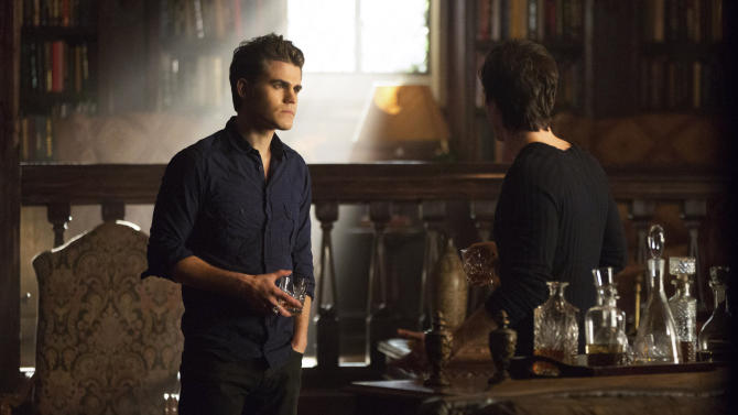 """This undated publicity photo released by The CW shows Paul Wesley, left, as Stefan and Ian Somerhalder as Damon, in a scene from Season 4 of the The CW television show, """"The Originals."""" (AP Photo/The CW, Bob Mahoney)"""
