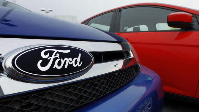 FILE - In thie July 1, 2012 file photo, the Ford logo is seen on cars for sale at a Ford dealership in Springfield, Ill. Ford is recalling nearly 485,000 Escapes and Mavericks to fix sticking gas pedals that can cause crashes. The worldwide recall affects the 2001 through 2004 model years that are powered by 3-liter V-6 engines with cruise control. It comes just over a week after U.S. safety regulators began investigating the Escape small SUV. The U.S. National Highway Traffic Safety Administration has received 68 complaints about the problem, including 13 crashes, nine injuries and one death. A teenage girl died in the January crash of an Escape in Arizona.(AP Photo/Seth Perlman)
