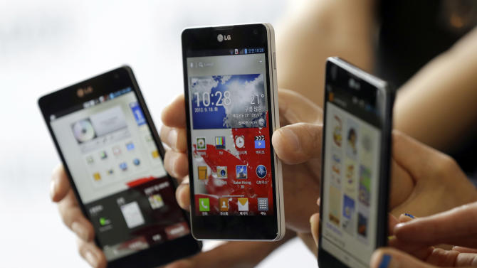Models pose with LG Electronics' new Optimus G smartphones during its unveiling ceremony in Seoul, South Korea, Tuesday, Sept. 18, 2012. LG Electronics will launch the Optimus G smartphone next week in South Korea, pinning hope on the new Android device to help revive its loss-making mobile business. (AP Photo/Lee Jin-man)