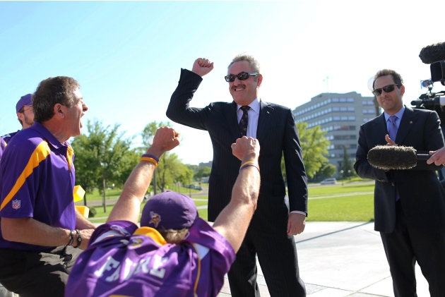 Minnesota Vikings owner Zygi Wilf greets fans outside the state Capitol before a news conference after the Vikings stadium bill passed in the Senate and the House on Thursday, May 10, 2012, in St. Pau