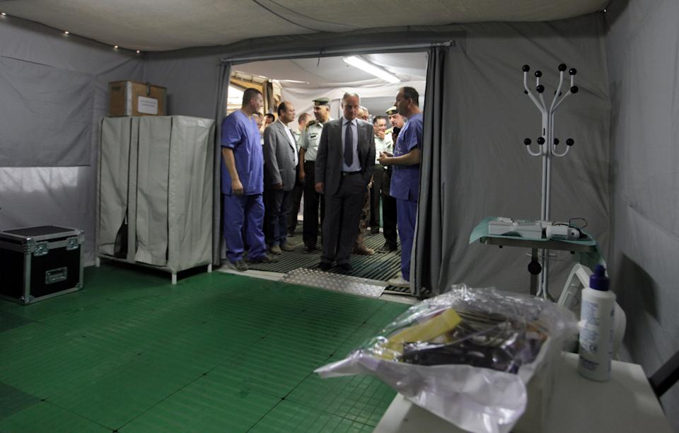 Francesco Fransoni, Italian ambassador to Jordan, second from right, tours the Italian Field Hospital for Syrian refugees, which was established in al-Mafraq city, Jordan, Tuesday, July 10, 2012. (AP Photo/ Mohammad Hannon)