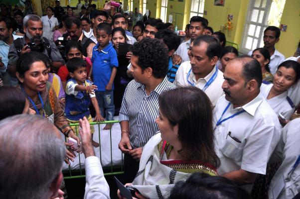Cricket legend Sachin Tendulkar and his wife Anjali meet patients at Nowrosjee Wadia Maternity Hospital where they also announced Little Hearts Marathon, in Mumbai on Jan.21, 2014. (Photo: Sandeep Mah