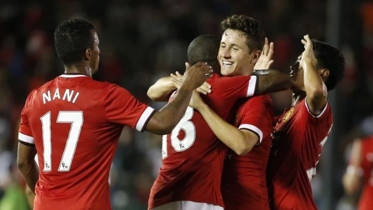 Manchester United midfielder Herrera of Spain celebrates with Young after Young scored against Los Angeles Galaxy during the second half of their international soccer friendly match in Pasadena