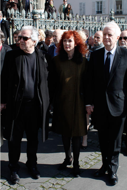 French actress and Alain Resnais' wife, Sabine Azema, center, actors Andre Dussolier, right, and Pierre Arditi, pay respect at the end of the funeral service for Resnais in the Saint Vincent de Pa