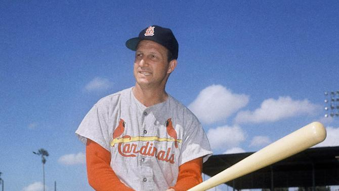 FILE- In this March 23, 1964 file photo, Stan Musial visits his former teammates at the St. Louis Cardinals spring training baseball camp in Florida. Musial, one of baseball's greatest hitters and a Hall of Famer with the Cardinals for more than two decades, died Saturday, Jan. 19, 2013, the team announced. He was 92.  (AP Photo/File)