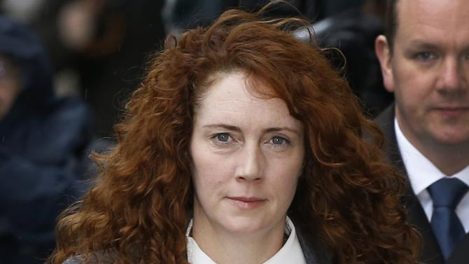 Rebekah Brooks arrives at The Old Bailey law court in London, Thursday, Oct. 31, 2013. Former News of the World national newspaper editors Rebekah Brooks and Andy Coulson are due to go on trial Monday, along with several others, on charges relating to the hacking of phones and bribing officials while at the now closed tabloid paper. (AP Photo/Kirsty Wigglesworth)