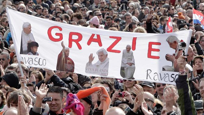 "Faithful hold up a banner with pictures of Pope Benedict XVI and writing reading in Italian ""Thank you"" as they attend Benedict's last Angelus prayer, in St. Peter's Square, at the Vatican, Sunday, Feb. 24, 2013. Benedict XVI gave his pontificate's final Sunday blessing from his studio window to the cheers of tens of thousands of people packing St. Peter's Square, but sought to reassure the faithful that he wasn't abandoning the church by retiring to spend his final years in prayer. The 85-year-old Benedict is stepping down on Thursday evening, the first pope to do so in 600 years, after saying he no longer has the mental or physical strength to vigorously lead the world's 1.2 billion Catholics. (AP Photo/Riccardo De Luca)"