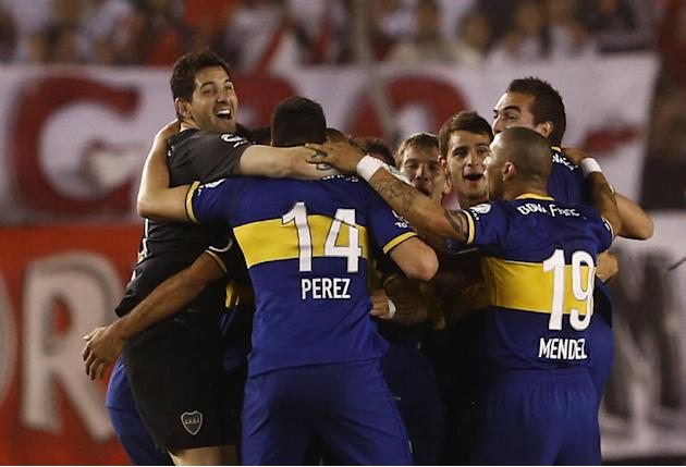 Boca Juniors' goalkeeper Agustin Orion, left, and teammates  celebrate after defeating River Plate in an Argentina's league soccer match in Buenos Aires, Argentina, Sunday, Oct. 6, 2013