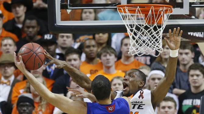 Oklahoma State forward Kamari Murphy (21) blocks a shot by Kansas forward Perry Ellis (34) during the first half of an NCAA college basketball game in Stillwater, Okla., Wednesday, Feb. 20, 2013. (AP Photo/Sue Ogrocki)
