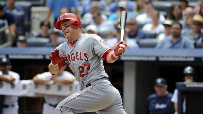 FILE - This July 14, 2012 file photo shows Los Angeles Angels' Mike Trout (27) hiting a single off of New York Yankees relief pitcher Freddy Garcia in the first inning of a baseball game at Yankee Stadium in New York. Trout is favored to win AL Rookie of the Year, Monday, Nov. 12, 2012.(AP Photo/Kathy Kmonicek, File)